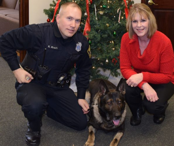 State Sen. Cathy Young has introduced legislation that would make it a felony to harm a police K-9. The push comes after K-9 Mitchell of the Jamestown Police Department was injured last year. Pictured with Mitchell and Young is handler Erik Kraft.  Submitted photo