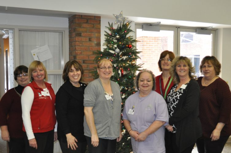 Sue Koresko is honored as the Lutheran Employee of the Year by members of the COPP (Collection of Positive People) Team. Pictured, from left, are Brenda Weiler, Gwen Axelson, Diana Pillittieri, Brenda Johnston, Sue Koresko, Barb Best, Shelly Quackenbush and Mollie Zoda.