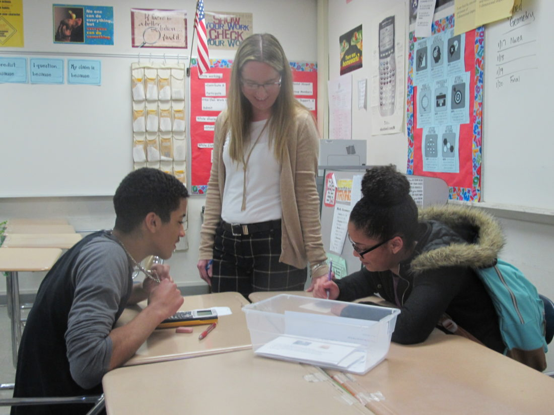 Raquel Ruch helps her students with math activities during her English as a New Language math support class. The class currently meets every other day to work on math and vocabulary skills.  P-J photos by Katrina Fuller