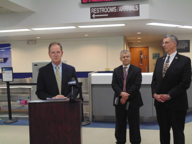 Ron Almeter was named new county Airports and Parks manager Friday at the Jamestown Airport terminal.  Spending time in the private sector and the military, Almeter said he's delighted to receive the opportunity to serve the community. Almeter is pictured alongside County Executive Vince Horrigan and George Spanos, county public facilities director.  P-J photo by Jimmy McCarthy