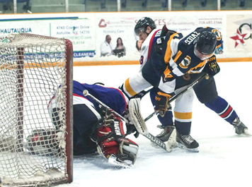 Jacob Zwieg of the Southern Tier Xpress tries to stuff the puck home in front of the net during Friday's NA3HL game against the Metro Jets.  P-J photo by Chad Ecklof