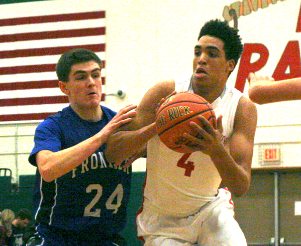 Jamestown's James Rojas, right, drives past Frontier's Zach Gerken during Saturday's ECICDivision 1 basketball game. P-J photo by Scott Kindberg