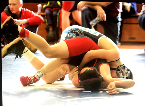 Frewsburg's Frank Iuculano, top, controls Olean's Zac Clark during 100-pound action in the 11 and 12 Division at the Panama Winter Wrestling Classic. Submitted photo