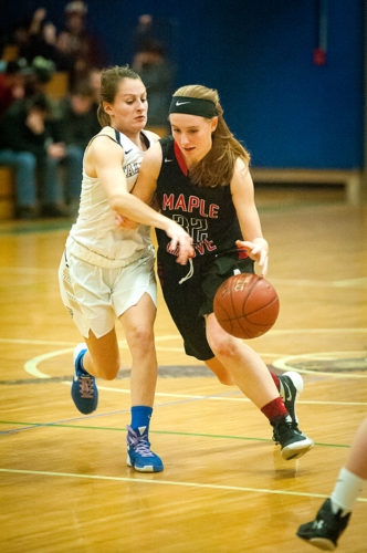 Maple Grove's Marisa Schuppenhauer dribbles around Falconer's Rachel Baglia during girls basketball action Monday in Falconer. P-J photo by Valory S. Isaacson