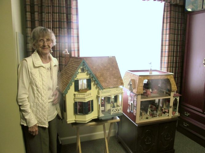 Nancy Anderson proudly displays her miniature houses, one of which is a replica of a general store in South Dayton. Anderson did have help from her family members at times, making the houses true family treasures.  P-J photos by Katrina Fuller