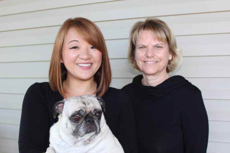 "Mary Carlson, right, is pictured with her daughter, Casey Carlson, and Casey's pug, Izzie. Mary recently published her second children's book, ""Princess Casey,"" in which the protagonist, who is loosely based on her daughter, seeks the source of her true happiness. Submitted photo"