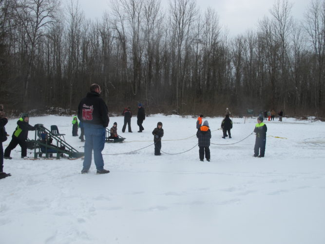 Klondike sled racing was a popular activity at the Winter Fun Day Camp at Camp Merz on Saturday. While the sleds are traditionally a Boy Scouts item, the younger cub scouts learned from the older boys how they worked.  P-J photo by Katrina Fuller