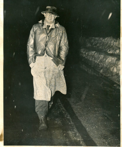 """In this Feb. 28, 1958 file photo, Mayville Central School basketball coach Francis """"Doc"""" Malinoski hikes home from Chautauqua High School after the Eagles defeated the Indians, 49-39. Malinoski had told his players he would walk home if they won. P-J file photo"""