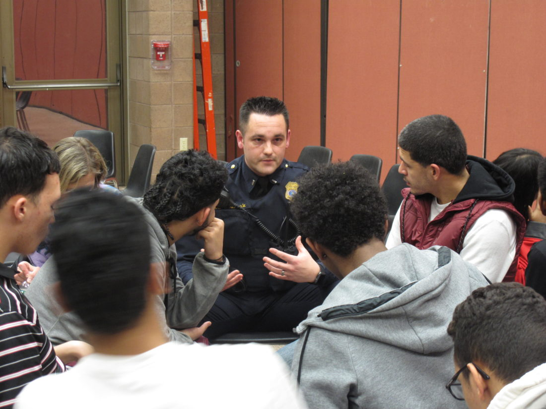 Lieutenant Greg Wozniak with the Jamestown Police Department talks to teen members of the Winifred Crawford Dibert Boys and Girls Club of Jamestown, who held a youth-led dialogue Wednesday on improving relations with local law enforcement. P-J photo by A.J. Rao