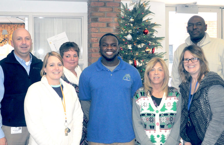 Members of the employee of the month team at G.A. Family Services congratulate Maceo Wofford on being selected as the G.A. Family Services 2016 Employee of the Year. From left, Timothy McMullen, interim director of education; Kimberly Breneman; Liz Lobb; Maceo Wofford; Donna Ciancio; Betsy Woleen; and Karl Wiggins; vice president of G.A. Family Services. Submitted photo