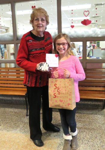 """Madelia Griffith, a 4th grader at Gail N. Chapman Elementary School in Randolph, has started her own business, """"Season's Sweet Sensations."""" She takes orders and makes a different themed cookie each month, then she donates a portion of the proceeds to a local charity. P-J photo by Deb Everts"""