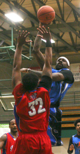 Jamestown's KB Baker puts up a shot over Kentucky's Gerald DeVaughn during Sunday's Premier Basketball League game at the Physical Education Complex at Jamestown Community College. P-J photo by Scott Kindberg