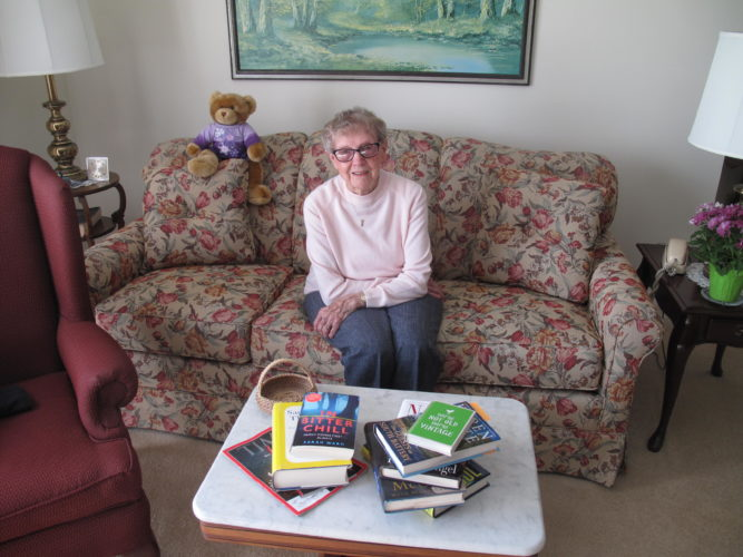 Evelyn Sundholm, a resident of Edgewood Communities in Jamestown, will be turning 100 years old Wednesday. Sundholm is an avid reader and frequent patron of the Falconer Public Library. In less than four years, she has read over 700 books. P-J photo by A.J. Rao