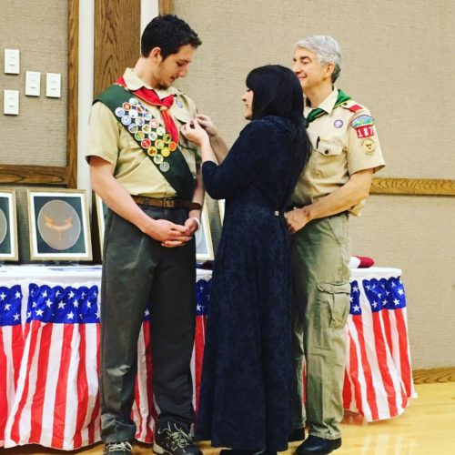 Thomas Gaskin of Warren, a member of Jamestown Scout Troop 187, receives the Eagle Scout Medal from his mother, Anna Gaskin.