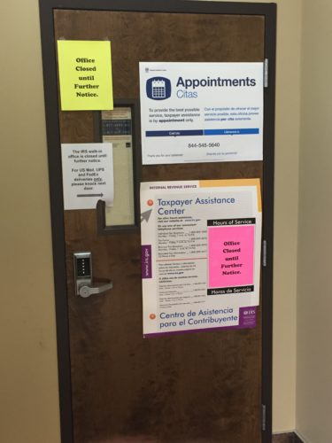 """Those looking for assistance at the local Internal Revenue Service office in Jamestown are encountering closed doors and signs stating closure """"until further notice."""" Pictured is the IRS office door.  P-J photo by Jimmy McCarthy"""
