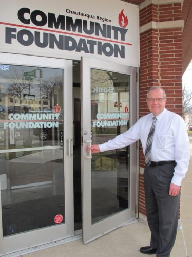Randy Sweeney at the entrance of the Chautauqua Region Community Foundation, located at 418 Spring St. Sweeney is retiring after serving 20 years as the executive director for the Chautauqua Region Community Foundation. P-J photo by Dennis Phillips