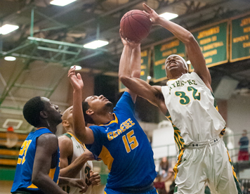 Jamestown Community College's Brandon Kemp (32) puts up a shot while being defended by Genesee CC's Jaheem Page on Wednesday night. P-J photo by Valory S. Isaacson