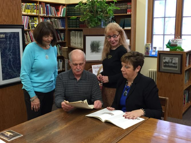 Pictured, from left, are Betty Palmer, Falconer  Public Library clerk; Joe Dispenza, Falconer  resident; Sue Seamans, Falconer Public Library director; and Brenda Cavallaro, Falconer historian.  Photo submitted by Laurie Becker