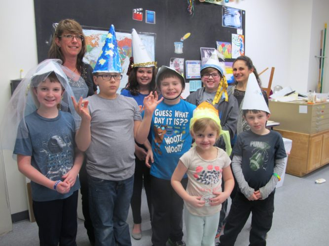 Campers, pictured with Renee Pye, art instructor at left, and Rachel Selice, camp coordinator, show off their work from Tuesday's Renaissance study. The students created their own Renaissance-themed hats.  P-J photo by Katrina Fuller