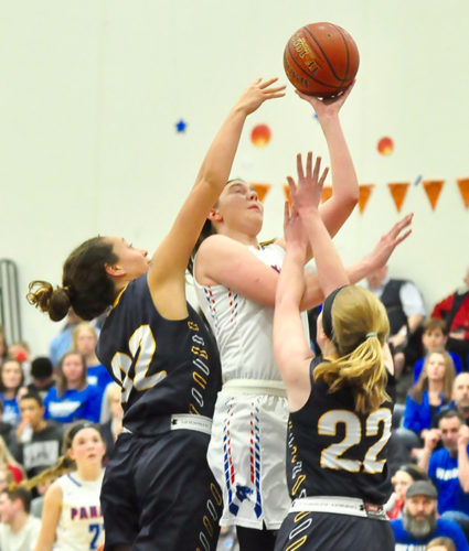 Panama's Nicole Johnson, middle, puts up a shot while being closely guarded by Sherman's Hannah Murdock (32) and Carrie Sands during Thursday's Section VIClass D quarterfinal basketball game. P-J photo by Scott Reagle