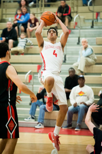 Jamestown's James Rojas scored a career-high 42 points to go along with 12 rebounds, five assists, two steals and two blocked shots as the Red Raiders beat Clarence, 63-57, in overtime Friday night in Section VIClass AA quarterfinal action at McElrath Gymnasium. P-J photo by Valory S. Isaacson