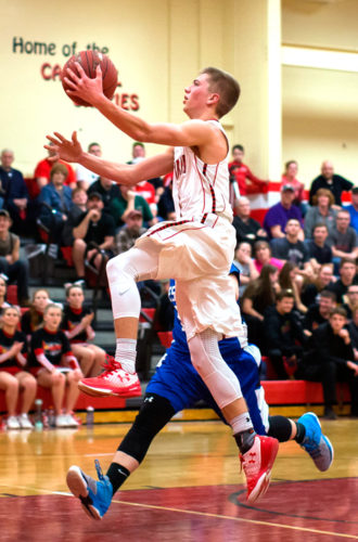 Randolph's Jake Beaver goes in for a layup against Westfield in Section VIClass C2 quarterfinal action Friday in Randolph. P-J photo by Tim Frank
