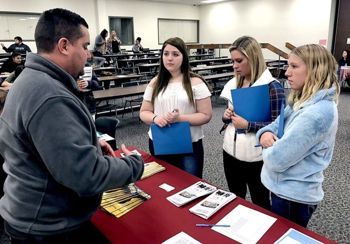 From left, Erie 2-Chautauqua-Cattaraugus BOCES Health Services students Mackenzie Maines (Brocton), Courtney Cassatt (Cassadaga) and Paige Errington (Lake Shore) meet with E.J. Hayes, Cassadaga Job Corps admissions counselor, to explore their options after they complete their program. Submitted photo