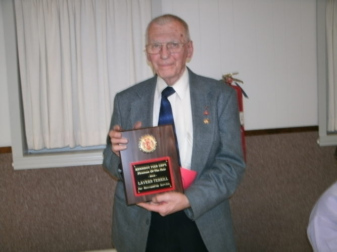 Lavern Terrill with his plaque for Fireman of the Year.