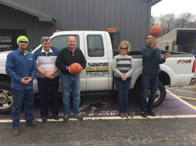 Pictured is Lakewood Family YMCA 3-on-3 March Madness Basketball Tournament major sponsor Signature Paving and Sealcoating officials, from left, Brandon Edson, Roger Carlson, Vince Joy, Amy Jensen and Jacob Tranner. Other sponsors include: Cricket Wireless, Media One Group, Kwik Fill Red Apple, Truck-Lite, and Team VP Real Estate.