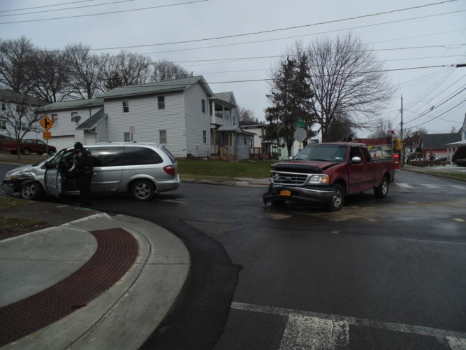 An accident at the South Main Street and Cole Avenue intersection in Jamestown resulted in minor injuries Friday morning. The incident, which took place around 11:40 a.m., occurred when a silver Dodge van traveling on South Main Street pulled out in front of a maroon Ford heading up Cole Avenue. The female driver and passenger in the silver van were treated on scene by Alstar EMS with minor injuries. The older male in the truck appeared unharmed. The van's corner panel suffered damage while the front of the truck had extensive damage. The Jamestown Police Department and Jamestown Fire Department assisted at the scene.  P-J photo by Jimmy McCarthy