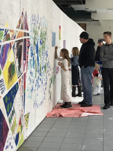 In the entrance to the artist showcase, children and their parents were invited to contribute to a mural.  P-J photo by Katrina Fuller