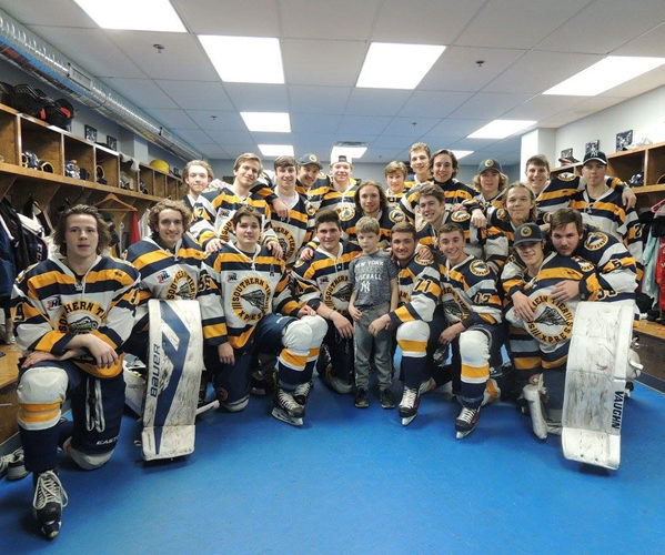 The Southern Tier hockey team surrounds Jacob Barber, middle, in the locker room prior to its final home game last month at the Northwest Arena. Jacob's invitation was issued by Xpress players Joey Gerace and Jacob Zwieg, who befriended the 10-year-old and his family this season. Photo courtesy of Cathy Barber