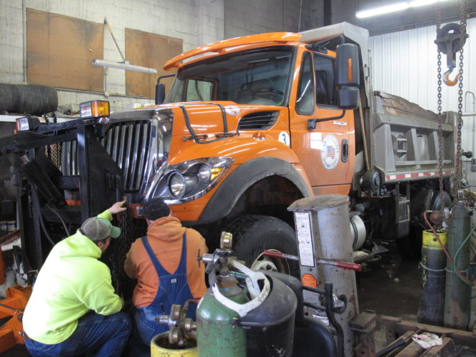 Members of the Ellicott Highway Department prepare to plow snow Wednesday. P-J photo by A.J. Rao