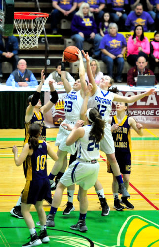 Panama's Madalyn Bowen (23), Natalie Angeletti (12) and Nicole Johnson (24) fight with Heuvelton players for a rebound during the 2016 NYSPHSAAClass D championship game at Hudson Valley Community College in Troy.  P-J file photos