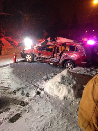 Pictured is the badly-damaged minivan driven by 19-year-old Joshua M. Verrett on Tuesday night. Verrett as reportedly driving too fast for the road conditions and collided into two parked vehicles on Falconer Street. Verrett was seriously injured and later taken to UPMC Hamot.