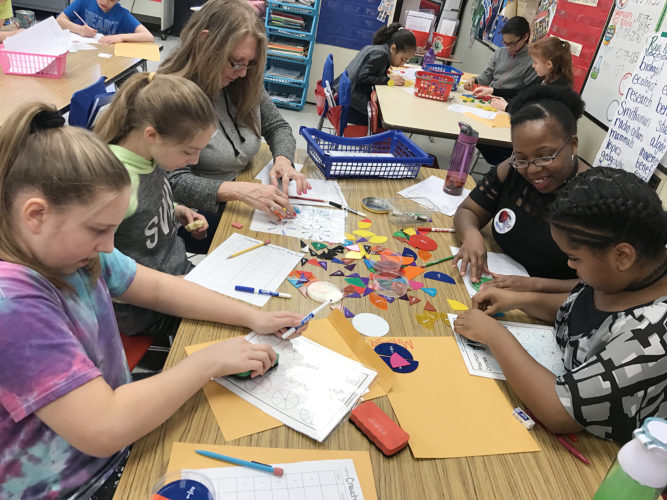 "Washington Middle School recently held a ""Bring Your Parents to School"" Day sponsored by the school's Family & Community Engagement Committee. Pictured are: Gabriella Zampogna, Alyson Canfield, Patti Denzel, Melissa Brown and Mikayla Brown who were working on an equivalent fractions activity in Deb Rein's fifth grade class."