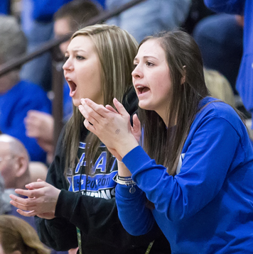 Kelsey Johnson, left, and Brittany Lenart cheer on the Lady Panthers on Saturday at Hudson Valley Community College. Photo by Deb Bailey