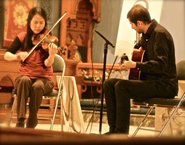 Dana Lyn, fiddle, and Kyle Sanna, guitar, play hop-jig with sounds of majestic Ireland. P-J photo by Todd Pullan
