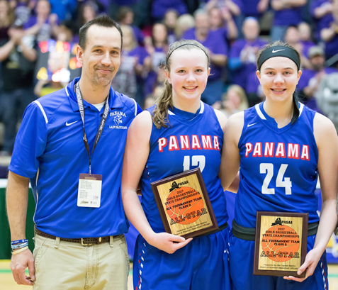 Coach Jeff Angeletti joins Natalie Angeletti, middle, and Nicole Johnson for a postgame photo after the two girls were named to the Class D all-tournament team. Photo by Deb Bailey