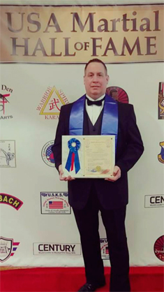 Area native Mark Weaver is pictured with his Kung-Fu Master of the Year award from the USA Martial Arts Hall of Fame that he received Saturday at a seminar/banquet in Jamaica, New York. Submitted photo