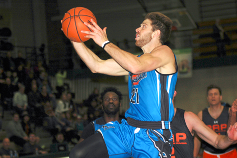 Kevin Crescenzi of the Jamestown Jackals drives to the hoop during Sunday's exhibition game against the Rochester Area All-Stars at Jamestown Community College. P-J photo by Scott Kindberg