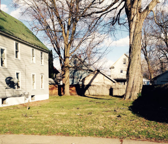This side lot at 734 Main St., Dunkirk, was one of the recent property dispositions of the Chautauqua County Land Bank Corporation. Its new owner, who lives on the adjoining parcel, has agreed to remove the diseased tree there that has been causing problems for some time. Photo by Rebecca Cuthbert