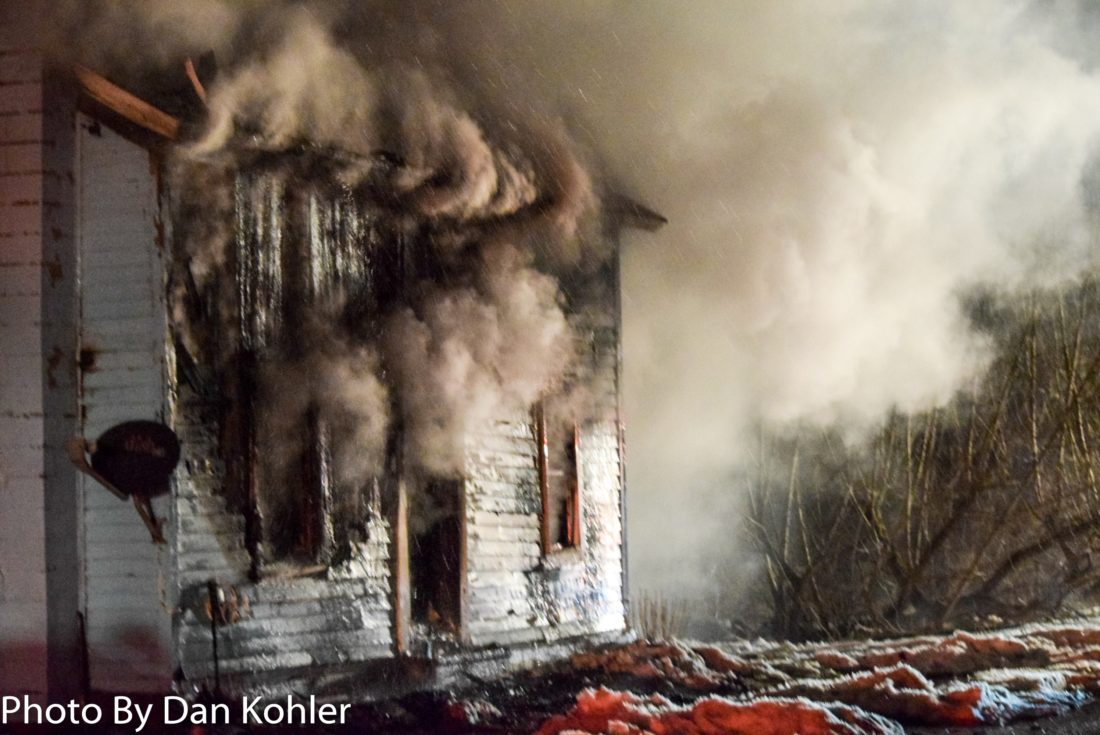 An early morning fire Monday devastated a home at 6485 Stockton-Cassadaga Road. Photo by Dan Kohler | Photo below by Eric Tichy