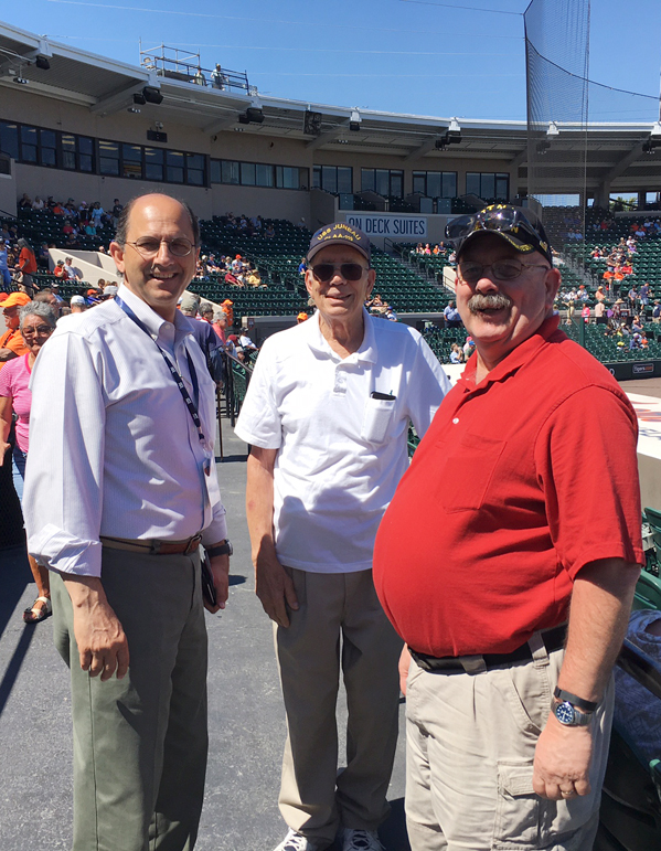 Jamestown residents Frank Stefanelli, center, and Bill Johnston, right, share a moment with Jamestown native Dan Lunetta, the director of minor league operations for the Detroit Tigers, last Saturday at Publix Field at Joker Marchand Stadium in Lakeland, Florida. Stefanelli, who will turn 90 in May, threw out the first pitch before the Tigers spring training game. Photo by Greg Peterson