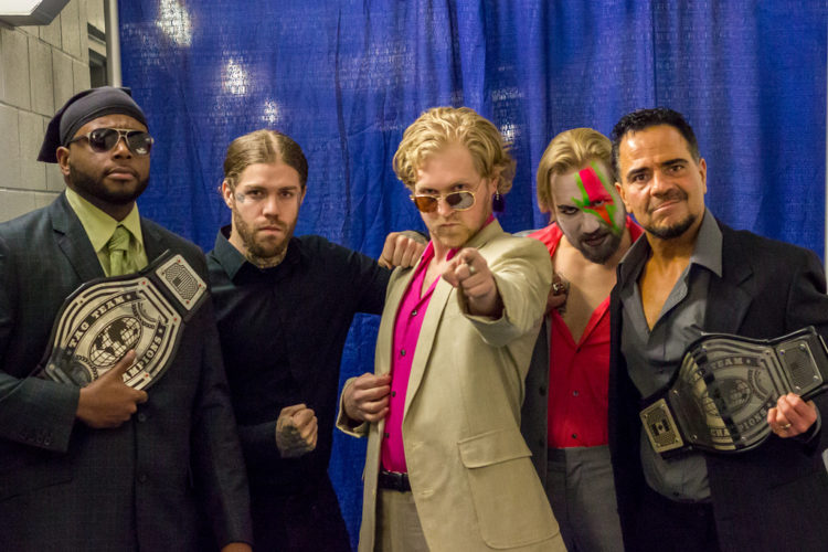 "Southern Tier Wrestling will present the first event of its second season, ""Gold Rush,"" at the Northwest Arena on Saturday, April 1, at 6 p.m. Pictured are current Southern Tier Wrestling tag team champions The Divine Alliance and their manager, Jon Kennedy. Submitted photo by Steve Vincent"