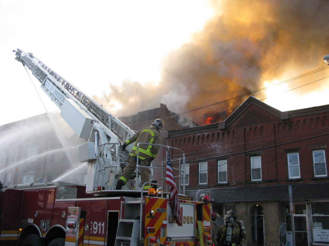 Several fire departments responded to the downtown structure fire in Falconer Wednesday.  P-J photo by Eric Tichy