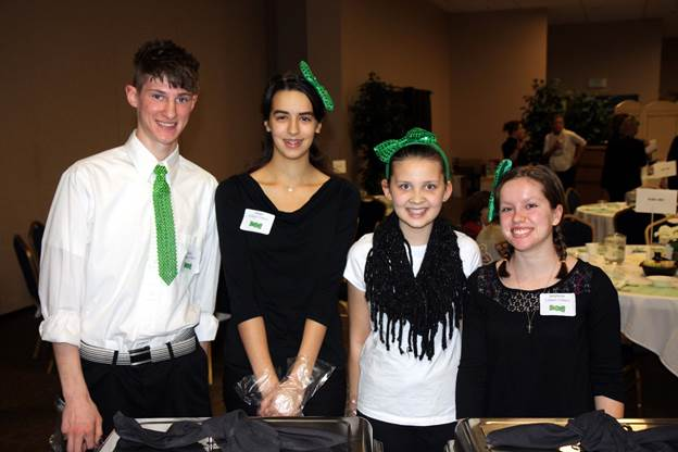 4-H members served more than 700 members of the community who came to support Chautauqua County 4-H at the Green Tie Affair held recently.  Submitted photo