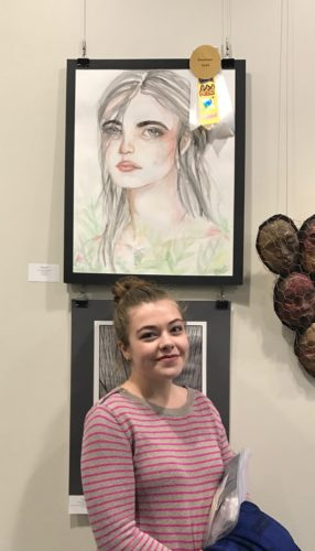 Emma Meyers, a junior at Southwestern High School, recently received the Bonaventure award during the opening reception for the Quick Center for the Arts Annual High school juried art show. Twenty-one schools entered over 300 works of art into the show, of which 100 were chosen for the exhibit. Of those works, the judges chose four exceptional works and those students were awarded $1,000 scholarships for the college along with various art supplies. Meyers is pictured with her winning artwork.