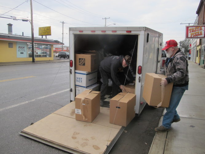 Bob Caldwell, owner of the Hogg Shoppe, and Don Phillips, owner of Picker's Choice, load up a trailer with donations for those who were displaced by the fire. As of Friday morning, the trailer was filled.  P-J photo by Katrina Fuller