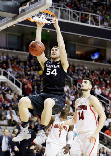 Xavier's Sean O'Mara dunks against Arizona in the Sweet 16 on Thursday night in San Jose, Calif. AP photo above